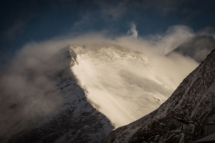 Scenics - Nature Beauty In Nature Mountain Cloud - Sky Sky Tranquil Scene Tranquility Non-urban Scene Nature Environment Cold Temperature Winter No People Mountain Range Landscape Physical Geography Idyllic Day Snow Outdoors Snowcapped Mountain Mountain Peak