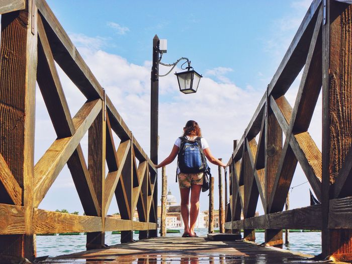 People Outdoors Day Leisure Activity Summer Lifestyles Vacations Tranquility Vacations Enjoying Summer Sunlight Bridge Wooden Bridge Girl Girl With Bag Traveller Seaside Looking Around Enjoying The Veiw  Summer Time  Adventure Colours Travelling Sommergefühle