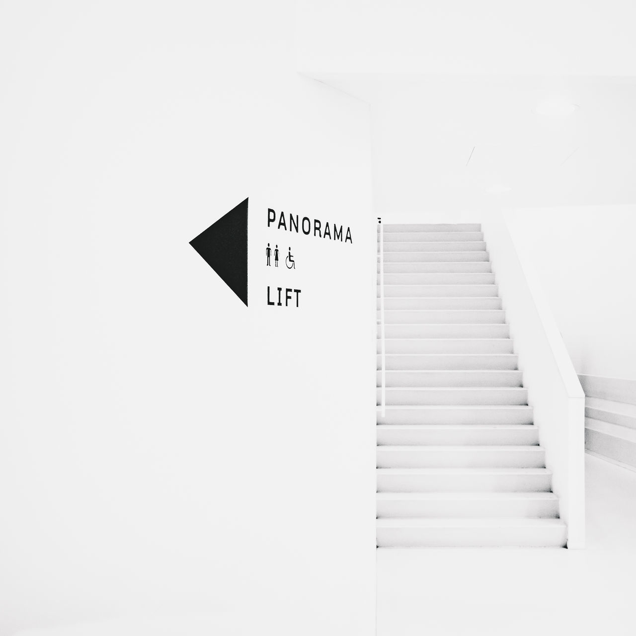 INFORMATION SIGN ON STAIRCASE