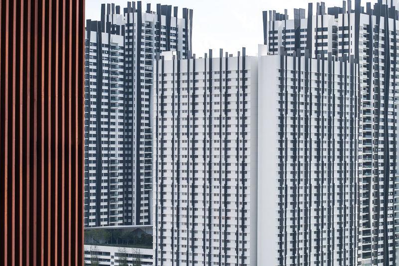 Exterior of modern buildings in city against sky