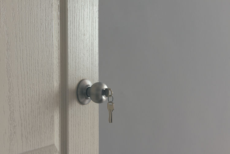 Close-Up Of Key On Doorknob At Home