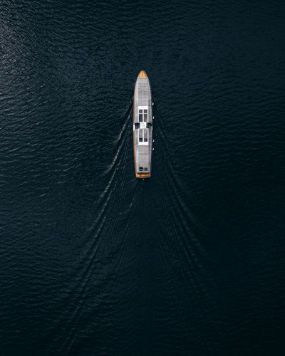 High angle view of ship sailing on sea. aerial boat perspective.