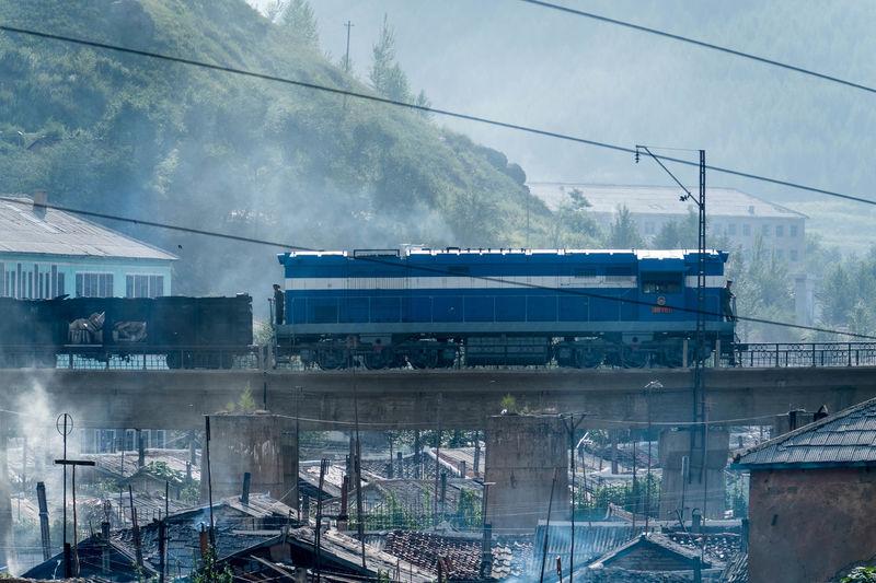 Hyesan, Ryanggang province, North Korea – August 7, 2017: Diesel locomotive making its way on a sunny morning. DPR Korea DPRK North Korea Transportation Day Infrastructure Locomotive Outdoors Railway Train Tranport