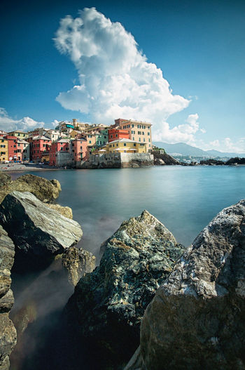 Vertical perspective series Boccadasse Long Exposure Longexposurephotography Longexposureoftheday Cloud - Sky Sea City Village Fishermanvillage No People Italy Genova Morning Light Blue Sky Building Exterior Architecture Water Sky Building Rock Nature Residential District Rock - Object Outdoors Professionalphotography