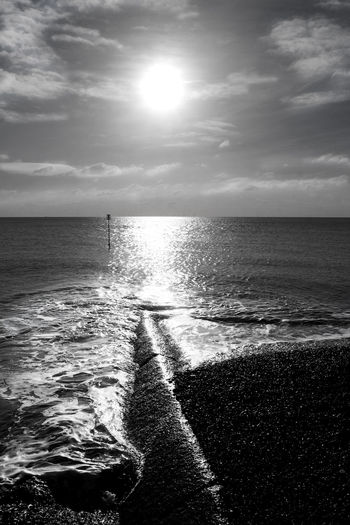Brighton Brighton Beach Water Sea Sky Horizon Horizon Over Water Scenics - Nature Cloud - Sky Beauty In Nature Beach Land Nature Sunlight Tranquil Scene Tranquility No People Sun Reflection Wave Outdoors Seascape Artistic Photo monochrome photography Black And White Photography