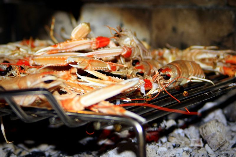 Crayfish grilling on barbecue
