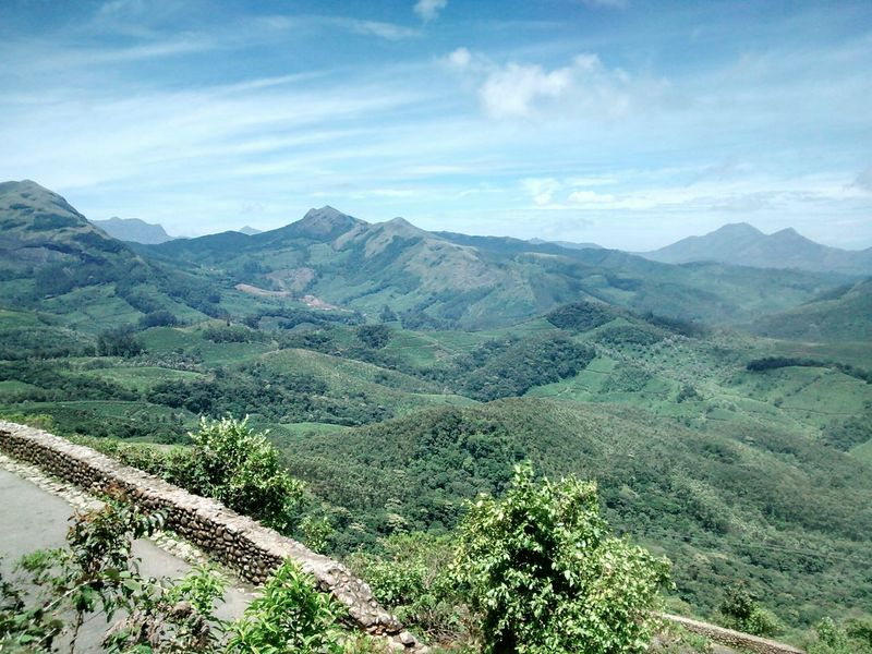 Munnar Kerala Mountain Scenics Tranquil Scene Mountain Range Tranquility Landscape Beauty In Nature Non-urban Scene Tourism High Angle View Idyllic Travel Destinations Sky Nature Majestic Day Outdoors Remote Winding Road Cloud - Sky