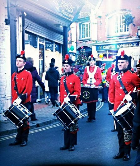 Adult Army Style Brass Band City Day Drummers Full Length Headwear Large Group Of People Men Musical Instrument Outdoors Parade People Real People Red Drummers Watching