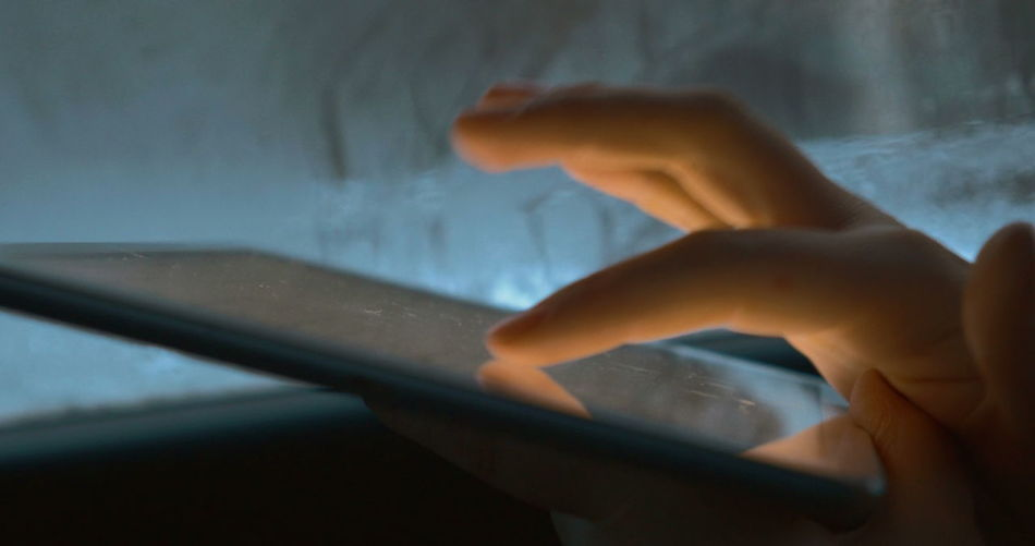 Close-up of person hand holding smart phone