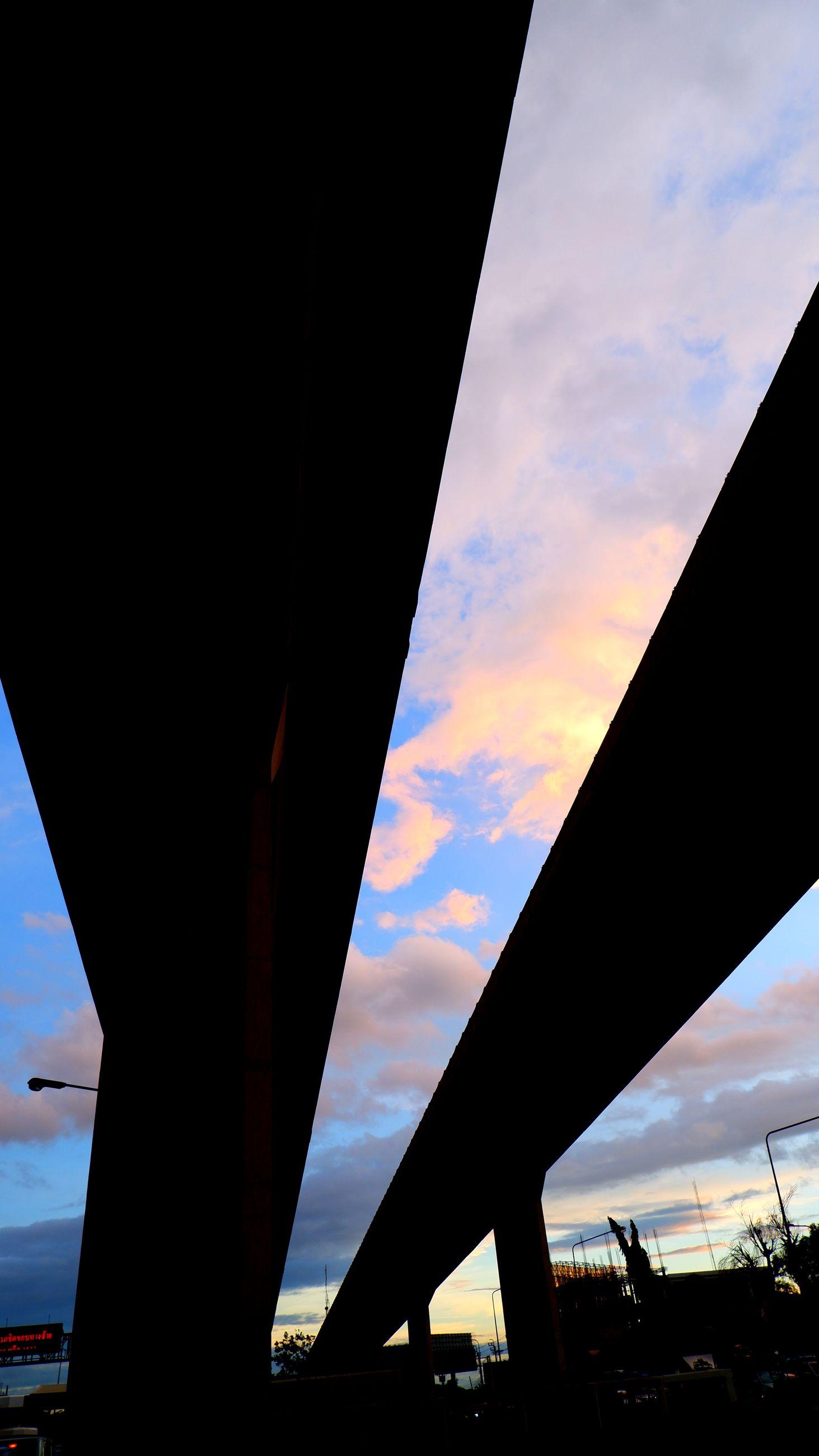 architecture, sky, transportation, built structure, sunset, bridge, silhouette, cloud, dusk, reflection, evening, nature, horizon, no people, sunlight, city, light, outdoors, road, mode of transportation, low angle view