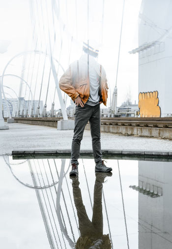 Reflection In The Water Juxtaposition Superposition Architecture One Man Only People Real People One Person Water Men Full Length Standing Young Men Reflection Bridge - Man Made Structure Cable-stayed Bridge Arch Bridge Suspension Bridge Railway Bridge Humanity Meets Technology My Best Photo