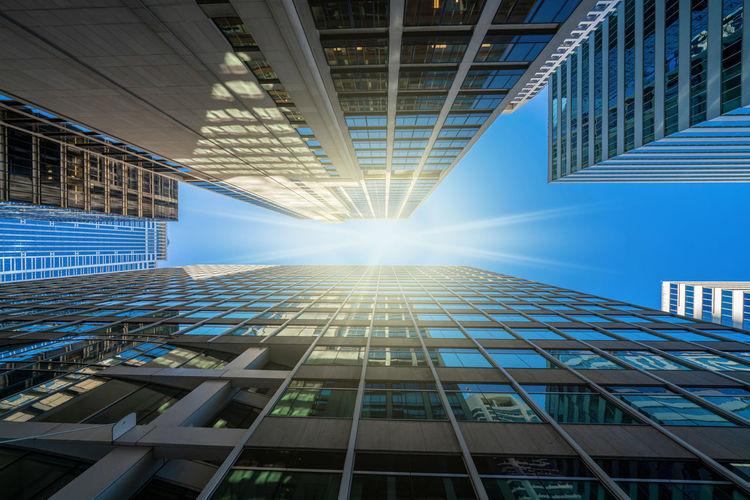 Sunbeam amidst modern office buildings