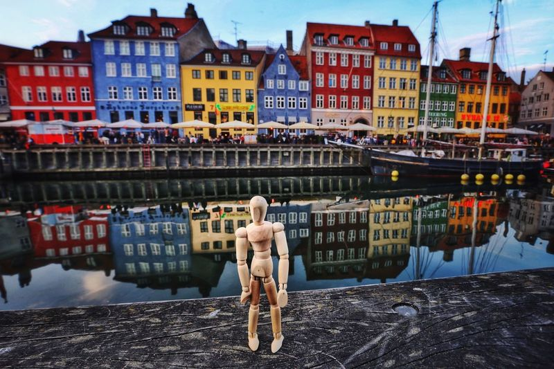 Colorful Copenhagen Colorful Copenhagen Creativity Woodyforest Building Exterior Built Structure Architecture City Building Water One Person Residential District Full Length Street Reflection Canal The Traveler - 2019 EyeEm Awards