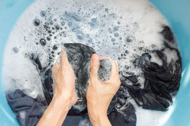 Hands washing black clothes in the blue basin. Basin Casual Cleaner Home Housework Laundry Washing Backgrounds Black Blue Body Part Bubble Clean Cleaning Clothes Clothing Dirty Hand Handwash Holding Washing Water