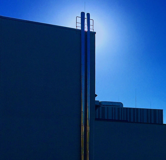 Background Photography Blue Building Exterior Built Structure Clear Sky Climate Change Day Factory Industry Lines And Shapes Low Angle View Metallic No People Outdoors Shadows & Lights Shapes And Forms Sky Sunshine Technology Ventilation Pipes Background For Quotes Innovation Future Vision Presentation Background