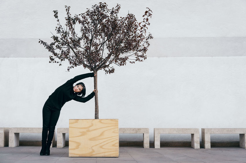 Architecture Tree Potted Plant Potted Tree One Person One Woman Only Women Young Women Bending Looking At Camera Posing Pretty A New Perspective On Life