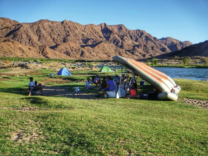 Enjoy The New Normal Outdoors Nature Day Sky Beauty In Nature Mountain Orange River Riverside River Life Camping River Rafting Friends Bliss People Landscape