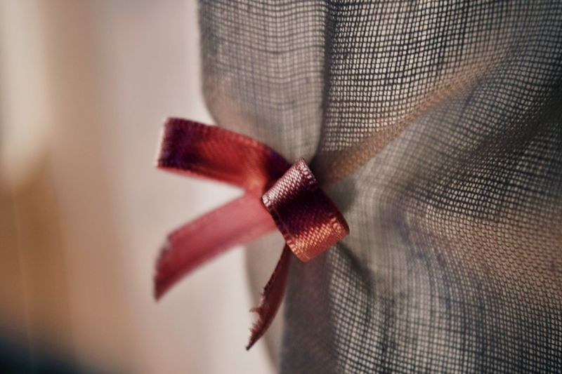 Close-Up Of Ribbon On Fabric