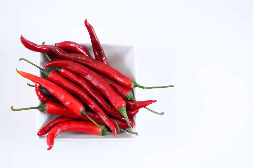 Cayenne Pepper Copy Space Herbs Herbs And Spices Ingredients Latin Mexico Spicy Bowl Chillies Chillies Red Close-up Food Food And Drink Freshness Hot Food Hot Peppers Jalapeños Red Red Chilli Pepper Room For Copy Spice Spices White Background
