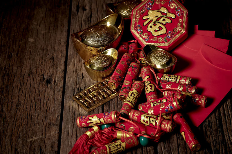 Chinese New Year Lunar New Year Good Luck Decoration Festive Wooden Table Luck Mascot Flat Lay Celebration Craft Firecrackers Ornament Gold China 2020 2019 Pig Minimal Sales Envelope Celebrations Flowers Lucky Tradition Symbol Red Fu Background Festival Spring Holiday Traditional Gold Culture Oriental Fortune Asian  ASIA Packet Plum Blossom Design Celebrate Greeting Prosperity Auspicious Money Happiness Firecracker Ingot Wood - Material Still Life Indoors  Text No People High Angle View Close-up Communication Large Group Of Objects Non-western Script Art And Craft Script Gold Colored Christmas Ornament