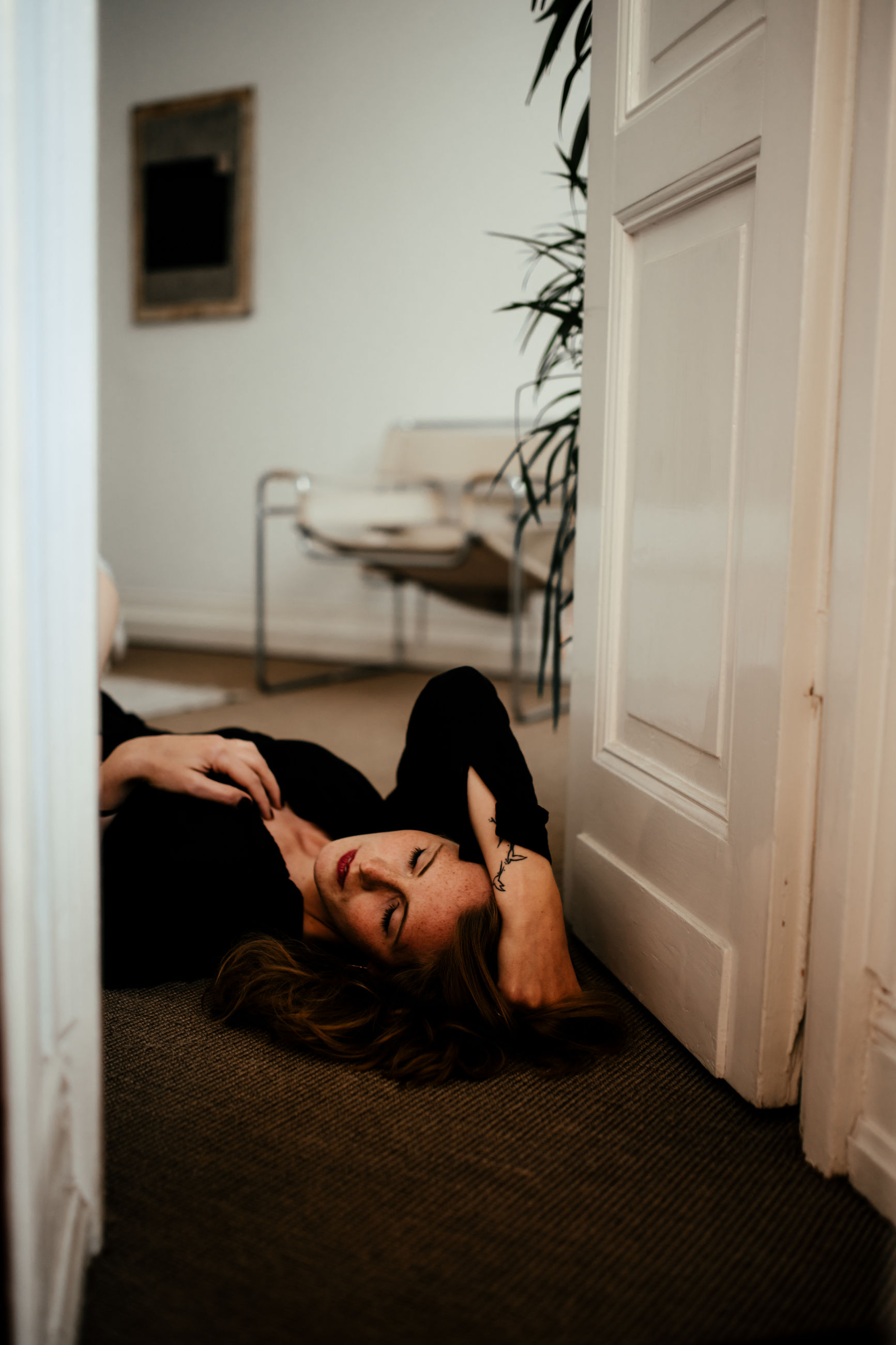 one person, young adult, real people, indoors, door, entrance, lifestyles, home interior, young women, lying down, relaxation, women, leisure activity, portrait, architecture, full length, adult, beautiful woman, hairstyle