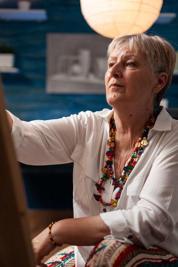 Mid adult woman looking at camera