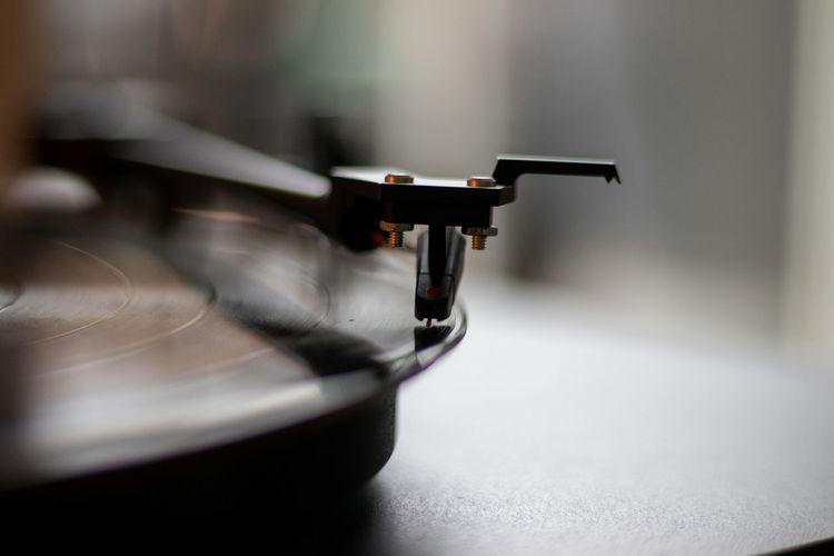 Close-up of ortofon pickup on vinyl record