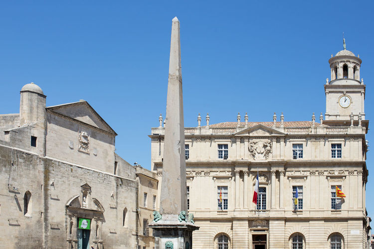 h section of the Place de la Republique, Arles Architectural Column Architecture Blue Building Exterior Built Structure Clear Sky Day Façade Historic History Low Angle View Medieval No People Old Town Outdoors Tall Tall - High Tourism Tower Travel Destinations