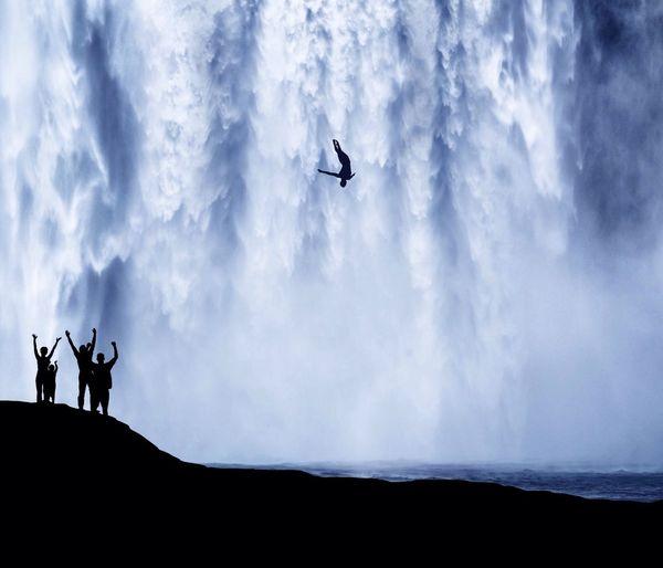 Silhouette People Overlooking Waterfall