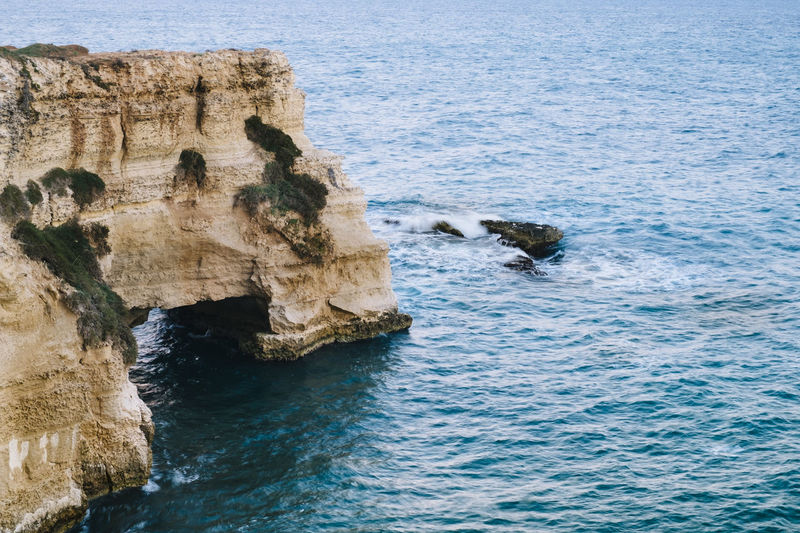 Beauty In Nature Coast Day Horizon Over Water Italy Nature No People Outdoors Perching Rock Formation Rocky Coast Rocky Coastline Salento Scenics Sea Sky Travel Travel Destinations Travel Photography Traveling Water