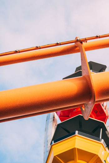 Low angle view of pipe against sky