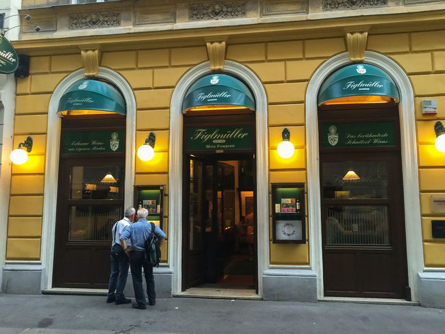 Figlmüller Restaurant / Vienna Adult Adults Only Architecture Austria Building Building Exterior Business Chicken City Day Figlmüller Full Length Menu Only Men Outdoors People Pork Restaurant Restaurant Decor Restaurants Schnitzel Togetherness Traditional Clothing Two People Vienna