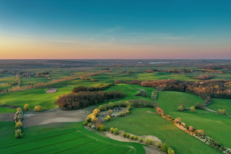 Aerial view of agricultural fields during sunset Drone  Dronephotography Mecklenburg Aerial View Aerial Image Aerial Photography Aerial Landscape Aerial Imagery Environmental Village Blossom Blooming Spring Rural Scene Agriculture Field Tree Sky Grass Landscape Green Color Plant In Bloom Airplane Wing