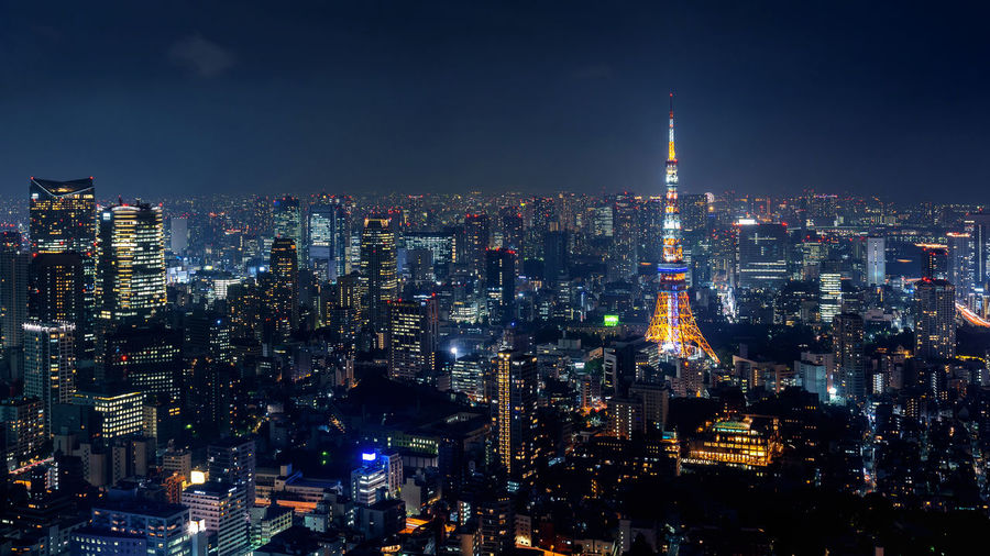 Tokyo cityscape at night, Japan. Architecture Building Building Exterior Built Structure City Cityscape Crowd Crowded Financial District  Illuminated Modern Night Nightlife Office Building Exterior Outdoors Residential District Sky Skyscraper Spire  Tall - High Tower Travel Destinations Urban Skyline