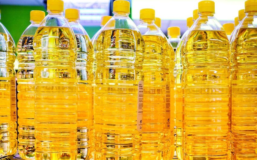 Pattern, Texture, Shape And Form Bottle Plastic Transparent Oil Vegetable Oil Olive Oil Sunflower Oil Golden Sunny Day Bright Colors Shop Yellow Backgrounds Full Frame Bottle In A Row Close-up Food And Drink Shelves Shop Shelf For Sale Retail Display Stall Repetition Arrangement
