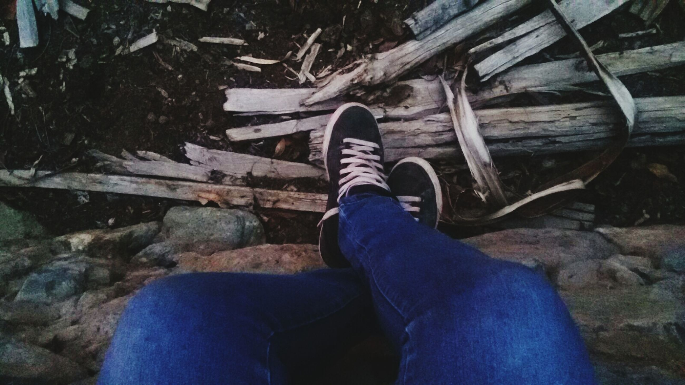 low section, person, shoe, lifestyles, jeans, personal perspective, high angle view, standing, leisure activity, casual clothing, blue, human foot, men, footwear, outdoors, day, sitting
