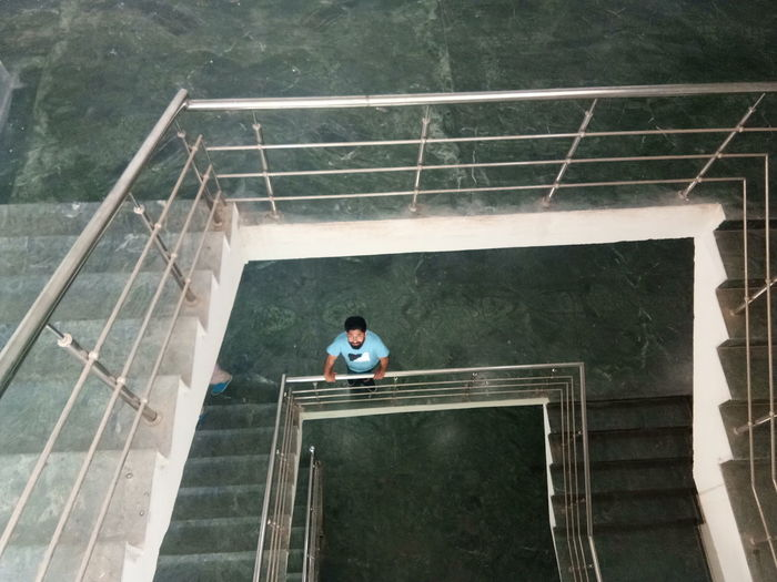 High Angle View Of Man Standing By Railing