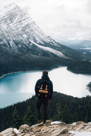 Travel. Mountain Backpack Real People Hiking Mountain Range Adventure Rear View Nature Beauty In Nature Full Length Leisure Activity Standing Scenics One Person Day Lifestyles Snow Lake Hiker Tranquility