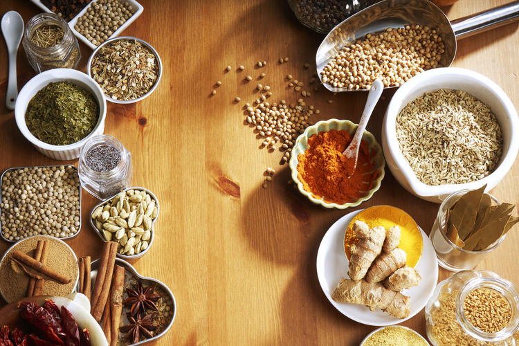 assorted spices and herb on the wooden table Chili Pepper Dried Food Herb Asian Food Assortment Choice Condiment Cumin Flavor Food Food And Drink Freshness Ground - Culinary High Angle View Ingredient Organic Paprika Pepper Seasoning Spices Still Life Turmeric  Variation Variety Various
