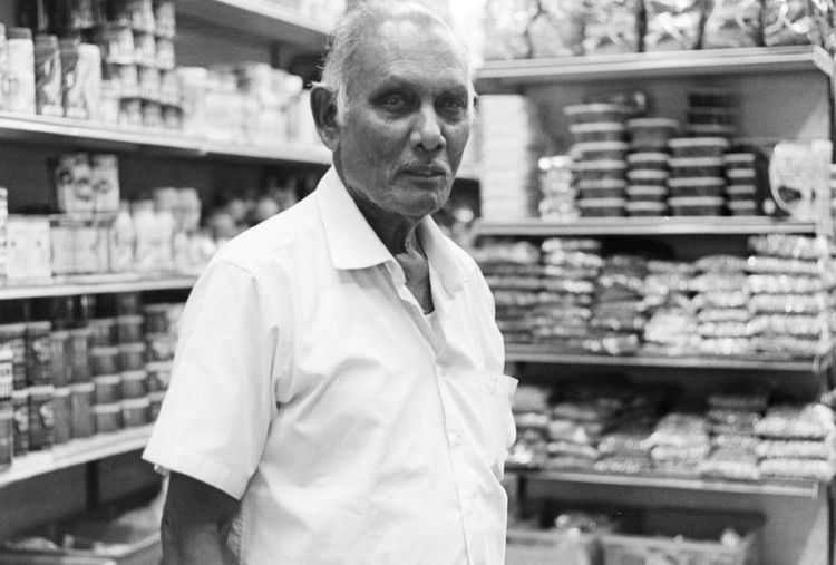 Shelf Retail  Mature Adult Adults Only Store One Man Only Mature Men Senior Adult Gray Hair Supermarket Men Food Only Men Portrait Consumerism Indoors  One Person Dairy Product Customer  Standing Monochrome