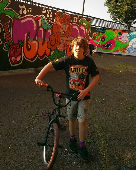 Cloud - Sky Casual Clothing Full Length Graffiti Childhood Sky Street Bicycle bmx Transportation Leisure Activity Multi Colored Creativity Outdoors Day