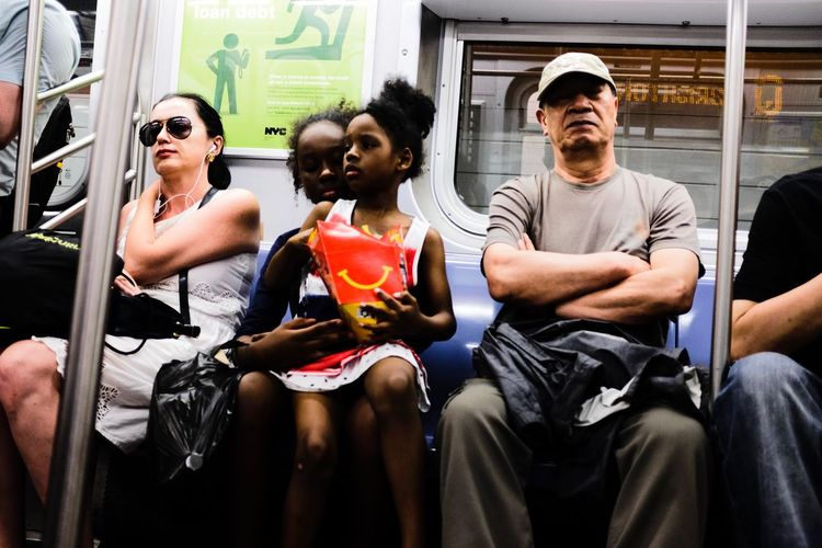 Fujifilm_xseries Sitting Group Of People Young Adult Lifestyles Real People Young Men The Street Photographer - 2018 EyeEm Awards Three Quarter Length People Adult Front View Glasses Casual Clothing Day Leisure Activity Men Women Fashion Sunglasses Young Women