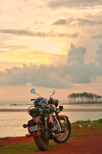 ||Royal Enfield|| Water Cloud - Sky Outdoors Sunset Beach Motorcycle Red Day No People Sand Landscape Sky Sea Nature Scenics Headwear Lifestyles Goa India Nature