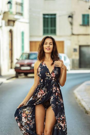 Portrait of beautiful woman on street in city