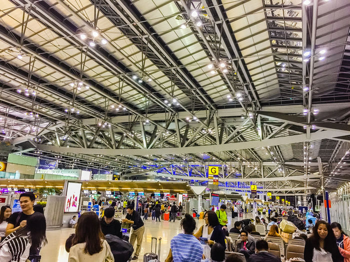 Bangkok, Thailand - November 20, 2015: Passengers arrive at Suvarnabhumi Airport to check-in for late flights at approximately 0400 hours. The airport handles 45 million passengers annually. Check-in Checking In Passenger Suvarnabhumi Airport Adult Adults Only Airport Ceiling Crowd Day Illuminated Indoors  International Airport Large Group Of People Late Flight Leisure Activity Lifestyles Men People Public Transportation Real People Sitting Standing Suvarnabhumi Suvarnabhumi International Airport Women