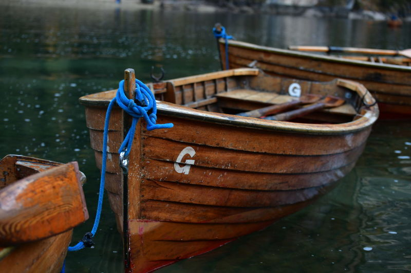 Close-up of rope tied to boat moored in river