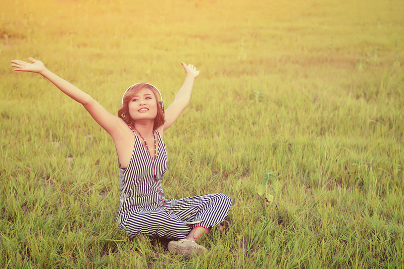 Arms Raised Casual Clothing Child Childhood Field Front View Grass Growth Happiness Human Arm Land Leisure Activity Lifestyles Limb Nature One Person Outdoors Plant Real People Smiling Women