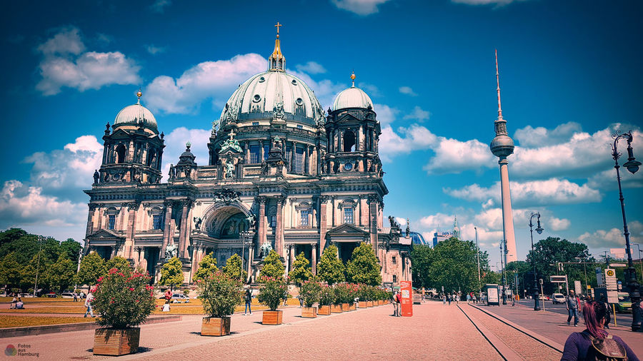 View of berliner dom building against cloudy sky