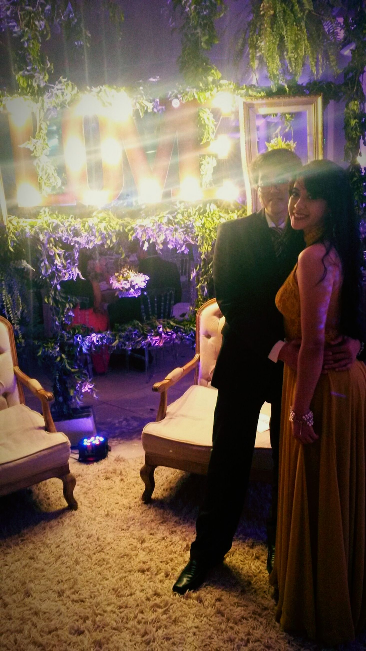 lifestyles, sitting, leisure activity, young adult, casual clothing, full length, person, young women, night, tree, relaxation, sunlight, illuminated, standing, chair, table, park - man made space