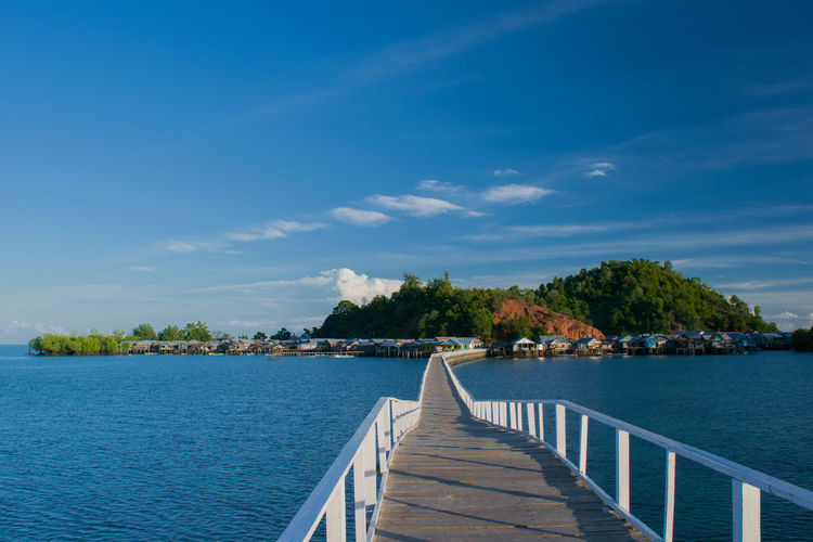 This is the bridge of Pandan Island in 02 August 2017 at the morning that connected the island to the main island of Tolitoli, the bridge is 300 meter long. Blue Water Tranquility The Way Forward Plant Sky Nature Island Bridge Over Water Bridge Calm Simplicity Beauty In Nature Tranquil Scene Built Structure Day Seascape Empty Morning Lights Wooden Bridge Over Water Wooden Bridge Sulawesi Tengah Tolitoli Sulawesi